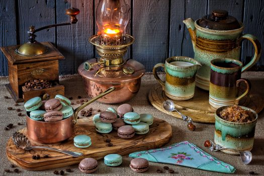 table, lamp, coffee mill, biscuit, kettle, still life