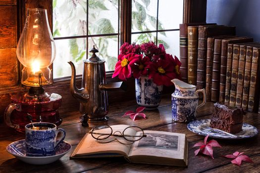 table, books, lamp, spectacles, Cup, vase, flowers, still life