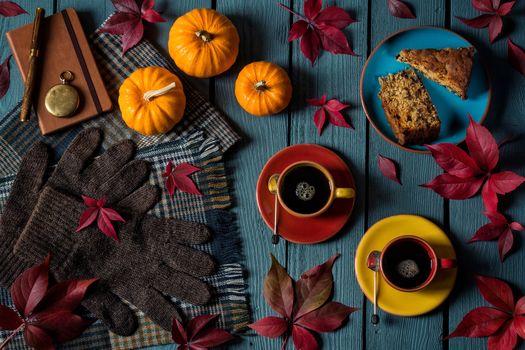 table, cups, gloves, cake, pumpkin, still life