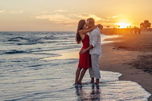 sea, sunset, man and woman kiss, mood, love