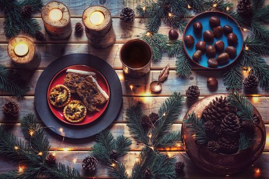 still life, candles, greenery, Festive table, chestnuts, pies, cones, Christmas
