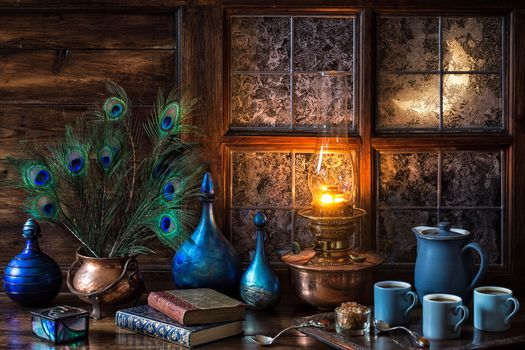 window, month, books, feathers, mugs, coffee, lamp, flame, still life