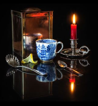 flame, candle, candlestick, a spoon, lemon, Cup, A cup of tea, tea, still life