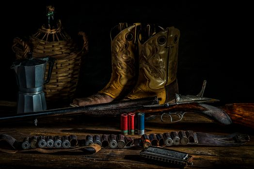 gun, Cartridges, boots, still life