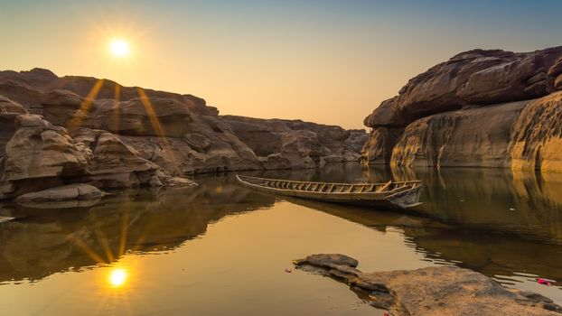 landscape, a boat, boats, water, nature, peace, relaxation, River, lake, sunset, dawn, rock, stones, the sun, rays, reflection
