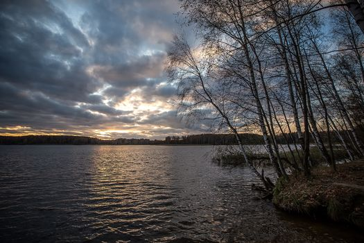 On the shore of Lake Uchinsky, Moscow region, Russia, autumn, sunset, Uchi lake, landscape