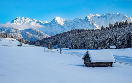 The ridge of Karwendel, In Mittenwalt, Upper Bavaria, winter, snow, the mountains, trees, houses, landscape
