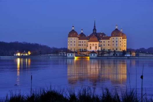 Germany, Saxony, Moritzburg, castle, evening, lights, light, water, reflection