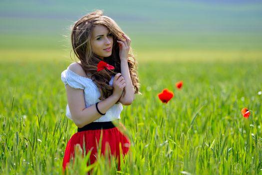 field, charm, girl, Poppies, Flowers, smile, muse, brown hair, wind