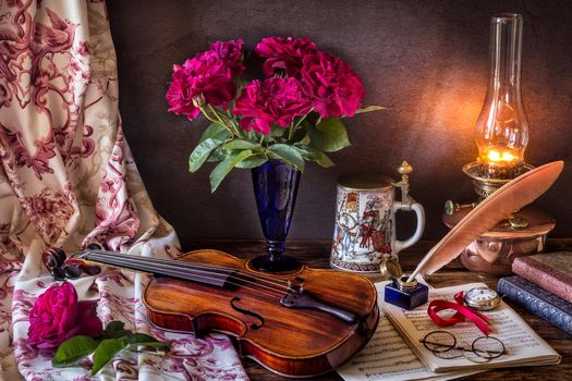 candle, vase, flowers, violin, notes, spectacles, still life