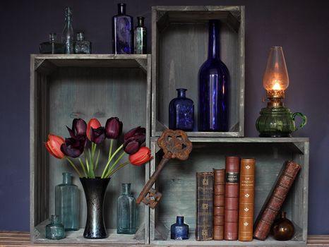 a shelf, flowers, key, books, still life