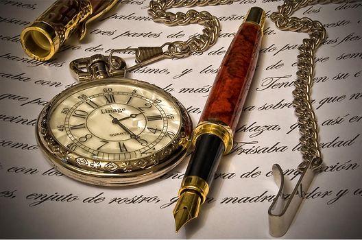 a pen, clock, letter, still life