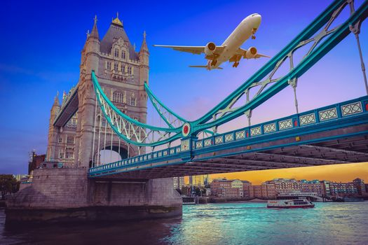 Tauэrskiy bridge, London, United Kingdom, aircraft, aircraft, flying over Tower Bridge at sunset in London
